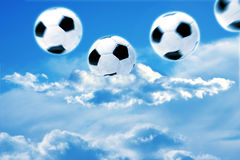 Soccer. Bouncing soccer balls in the sky Royalty Free Stock Photo