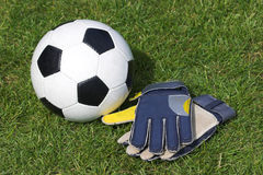 Soccer. Classic soccer ball and gloves laid out on grass stock photography