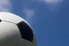 Soccer. Classic soccer ball against a sky blue and cloud background stock image