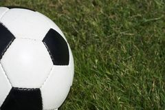 Soccer. Classic soccer ball against a grass background royalty free stock photo