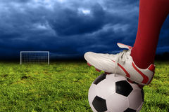 Soccer. Player foot and ball in the pitch Stock Image