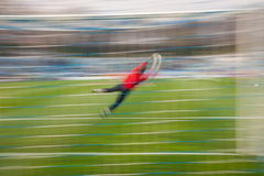 Soccer. Goalkeeper struggles to block soccer ball from hitting the net Royalty Free Stock Photo