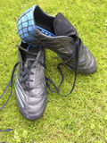 Soccer. Shoes on the grass Stock Photos
