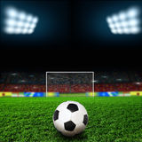 Soccer. Ball on the green field Stock Images