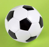 Soccer. Black white football on green background Royalty Free Stock Image