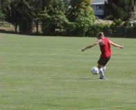 Soccer. Woman kicks soccer ball Stock Photography