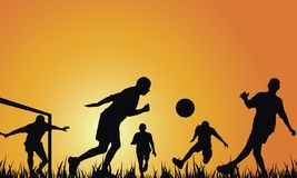 Soccer. People playing in soccer on sunset (backlit f/x Royalty Free Stock Photo