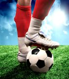 Soccer. A close up of a soccer ball and a soccer shoes Royalty Free Stock Image