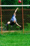 Soccer. Player kicking the ball from the air Stock Photo