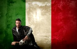 Soccer. Player on a italy flag background Royalty Free Stock Photos