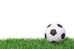 Soccer. A fine green meadow with a soccer ball on it. All on white background Stock Photos