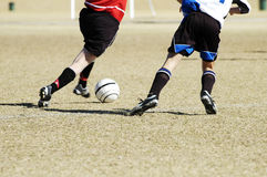 Soccer action 10. A fight for the soccer ball in a youth soccer game Royalty Free Stock Photo