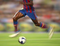 Soccer Action. Soccer player legs in motion Royalty Free Stock Images