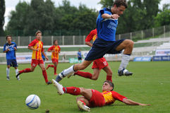 Soccer action. KAPOSVAR, HUNGARY - JULY 25: Unidentified players in action at the V. Youth Football Festival Under 17 Final - Pantelimon Bucuresti (Romania) vs Stock Image