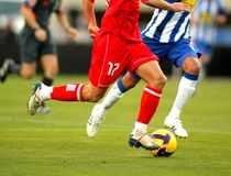 Soccer action. Soccer player legs in action Royalty Free Stock Photos