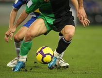 Soccer action. Soccer player legs dribbling in a match Stock Photo