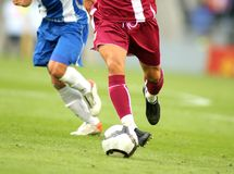 Soccer action. Soccer player legs in action Royalty Free Stock Image