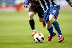 Soccer action. Soccer player legs in action Stock Photo