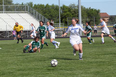 Soccer Action. Waukesha atatck player closes in on loose ball. Waukesha West HS Varsity played Greenfield HS in a Girls WIAA Soccer game in Waukesha, WI on June Stock Photography