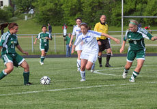 Soccer Action. Waukesha defender tried to take ball away from Greenfield. Waukesha West HS Varsity played Greenfield HS in a Girls WIAA Soccer game in Waukesha Stock Photo