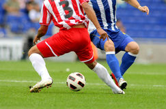 Soccer action. Soccer player legs in action in a competition Stock Images