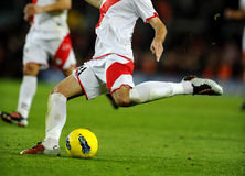 Soccer action. Soccer player legs in action Royalty Free Stock Photography