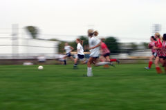 Soccer Action. Girls soccer game with a long shutter to show motion of the game Stock Photo