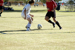 Soccer Action. Players position themselves for control of the ball in a girl's soccer game Royalty Free Stock Photo