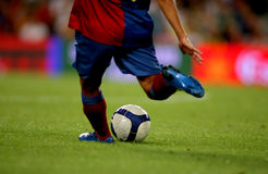 Soccer Action. A soccer player shooting a ball Stock Photo