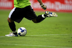 Soccer Action. A soccer goalkeeper shooting a ball Stock Photography