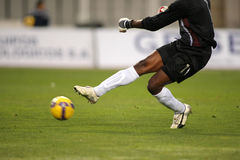 Soccer Action. A soccer goalkeeper shooting a ball during a match Stock Photos