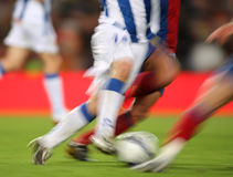 Soccer Action. Soccer player legs shooting a ball Stock Photography