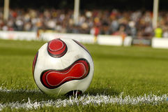 Soccer Afternoon. Close up of a Football on the grass Royalty Free Stock Image