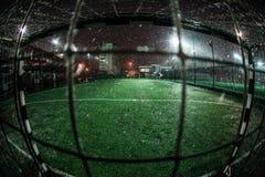 Soccer arena in night illuminated bright spotlights stock photos