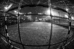 Soccer  arena in night illuminated bright spotlights. Soccer background, soccer ball, soccer stadium, arena in night illuminated bright spotlights, soccer goal Stock Photos