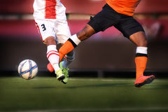 Soccer attack. Player legs of soccer sport with ball Royalty Free Stock Photography