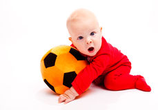 Soccer baby. Surprised soccer baby with his mouth wide open Royalty Free Stock Photo