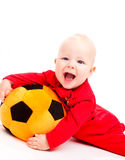 Soccer baby. Laughing baby with the soccer ball Stock Image