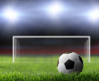 Soccer background. Soccer ball on green stadium Royalty Free Stock Photography