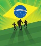 Soccer Background Brazil. Soccer player on green light background with brazil flag Royalty Free Stock Image