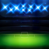 Soccer background with spotlight. Soccer stadium background with spotlight at night Royalty Free Stock Images
