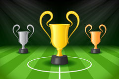 Soccer Background with Three Award Trophy Stock Photography