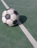 Soccer ball. A soccer ball on a green ground with diagonal line Stock Images