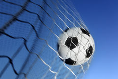Soccer ball. Kicked into the back of a goal royalty free stock photo