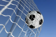 Soccer ball. Kicked into the back of a goal Stock Photo