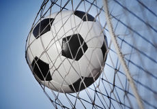 Soccer ball. Kicked into the back of a goal Royalty Free Stock Image