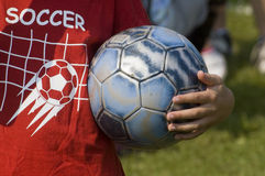 Soccer ball. Close up of young child holding a soccer ball Stock Photos