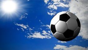 Soccer ball. A soccer ball fly in a sunny sky Stock Photography