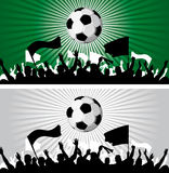 Soccer ball. (football) with silhouettes of fans Royalty Free Stock Photo