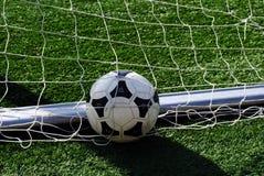Soccer Ball. A soccer ball in the net Stock Photos